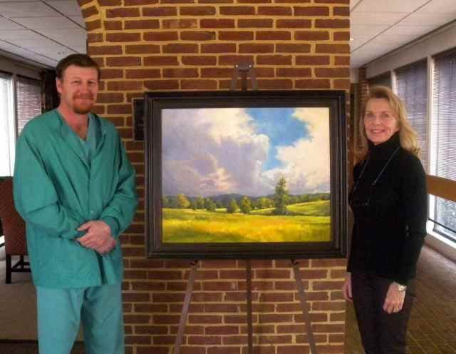 "Jean Schwartz (R) and Dr. James Brown (L) with ""Storm Clouds Over Morven Park"", on exhibit at the Marion DuPont Scott Equine Medical Center in Leesburg Virginia through Dec 31."